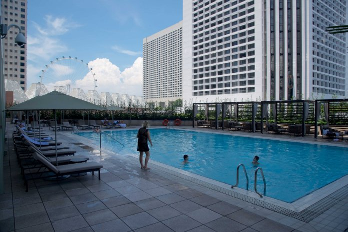 Open-air swimming pool, with views of the Singapore Flyer