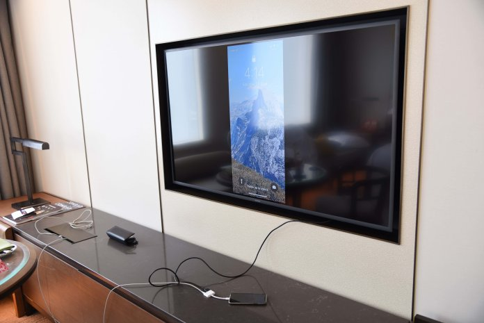 Adjustable TV with connectors accessible on the right