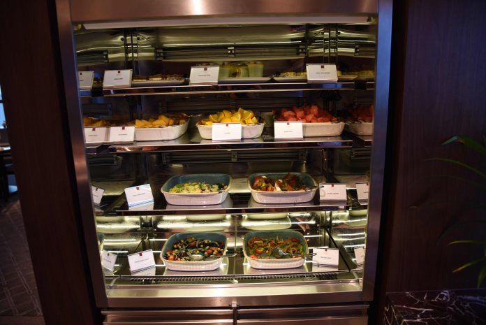 Salad, desserts and fruits in the chiller