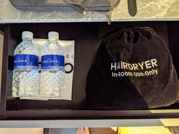 Hotel Soloha- Bottled water and hairdryer