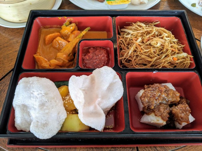 """Bento box"" bee hoon with vegetable curry, fruit rojak and rice cake"