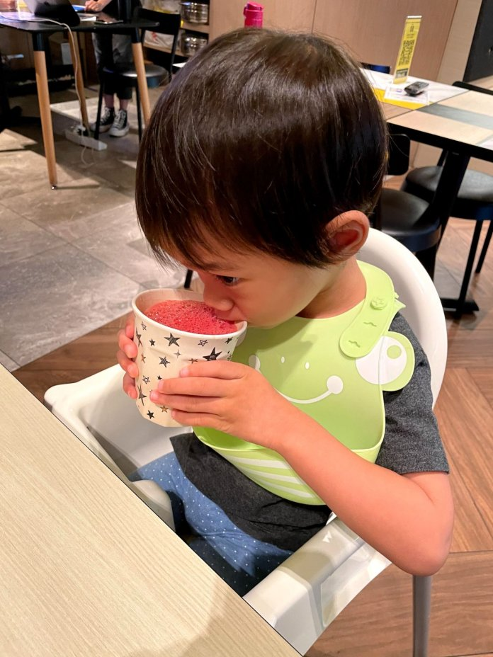 Toddler drinks watermelon juice